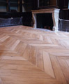 Chevron parquet floor front of his fireplace